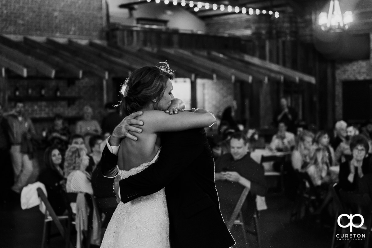 Bride hugging her dad.