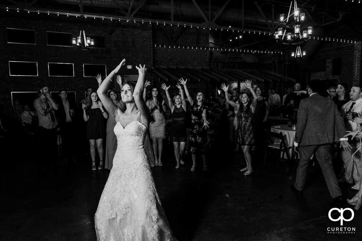 Bride tossing her bouquet.