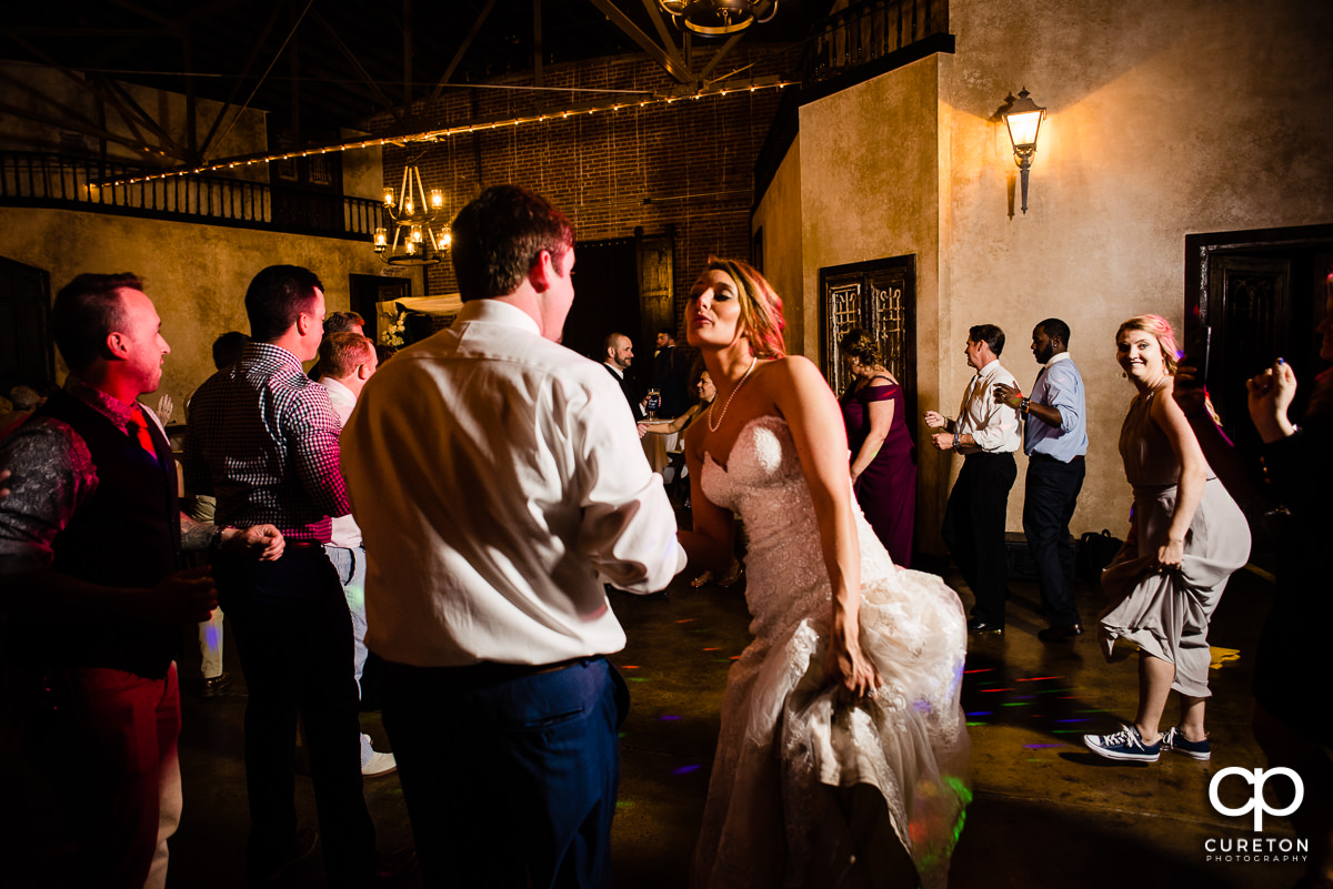 Bride dancing during the wedding reception.