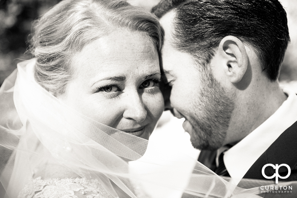 Close up black and white of bride and groom.