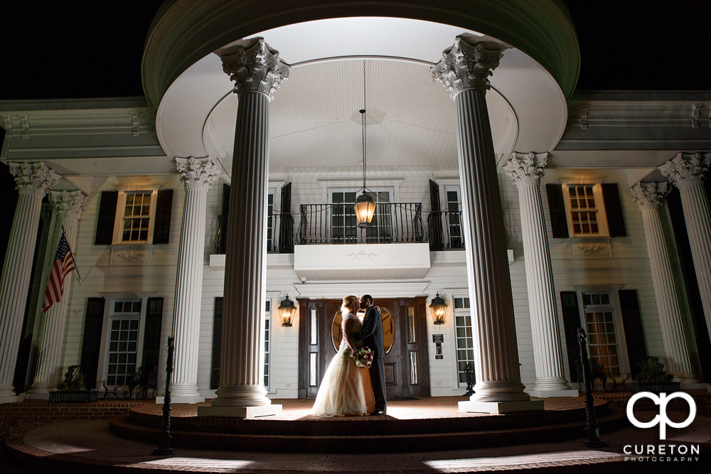 Epic shot of a bride and groom in front of the Ryan Nicholas Inn