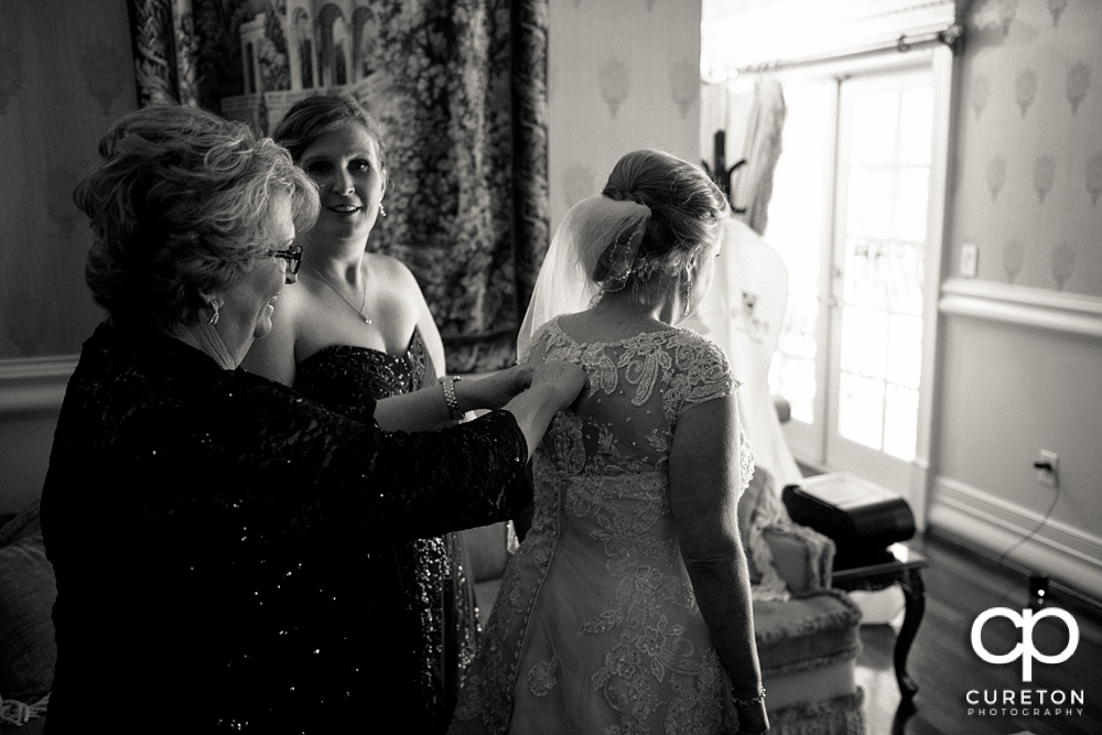 The bride putting her dress on.