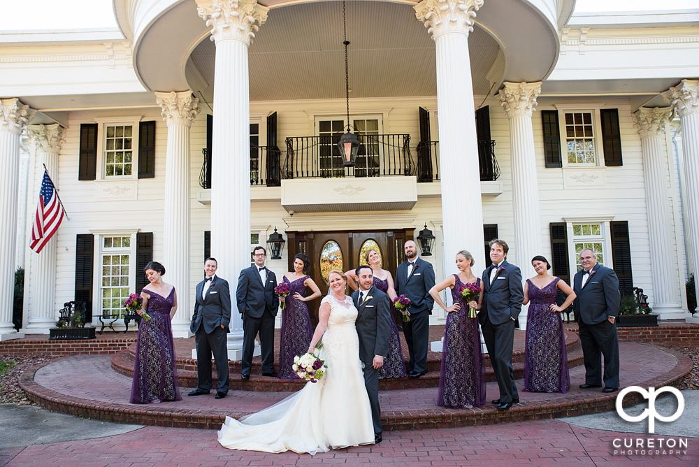Epic wedding party photo in front of the Ryan Nicholas Inn.