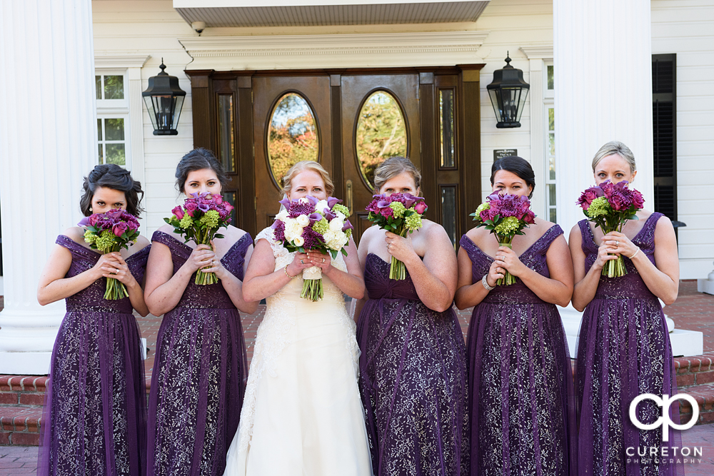 Bridesmaids with flowers.
