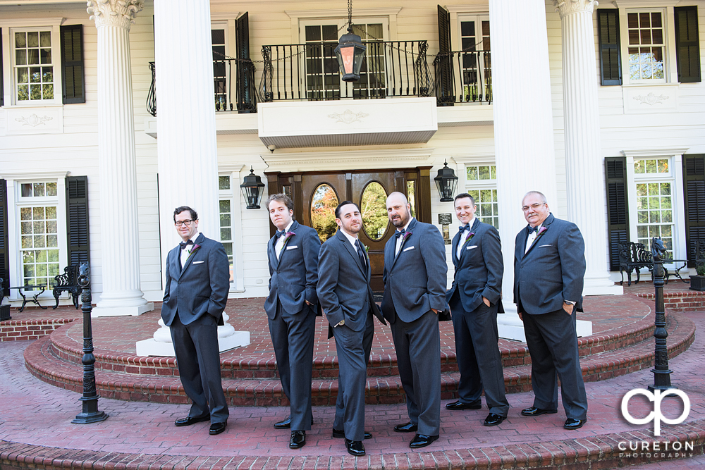The groom and groomsmen out in front of the Ryan Nicholas Inn.
