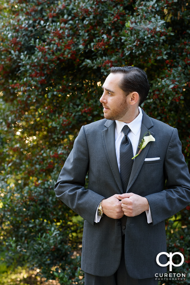 The groom standing outside.