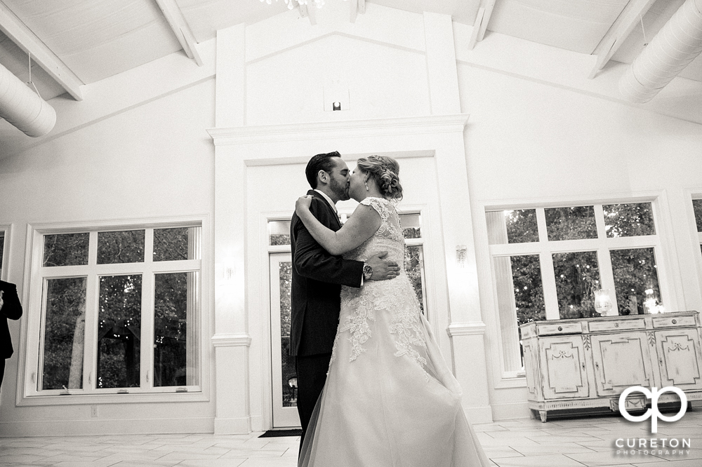 Bride and groom first dance in the pavilion.