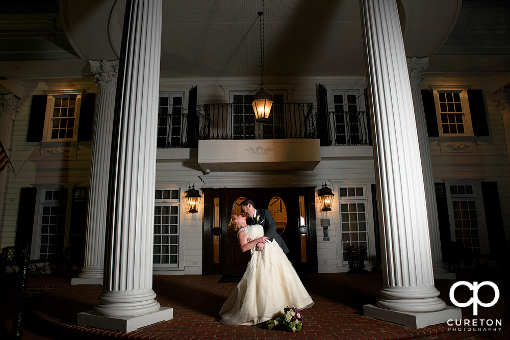 Bride and groom dipping out in front of the Ryan Nicholas Inn.