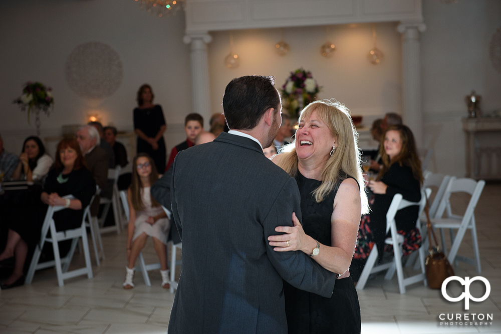 Groom and mother dance.