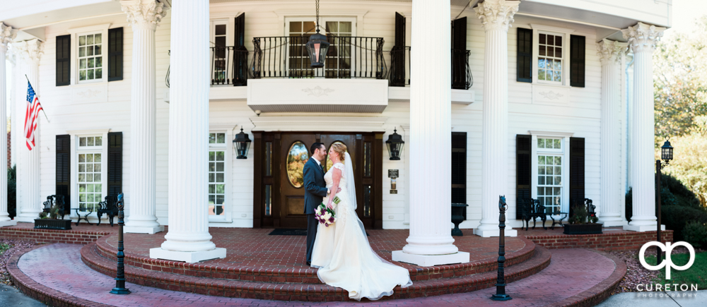 Bride and Groom pano in front of the Ryan Nicholas Inn.