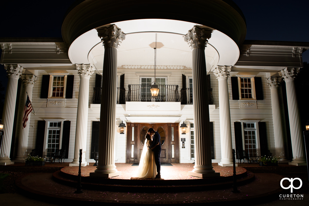 Epic shot of newlyweds in front of the house after their Ryan Nicholas Inn wedding.