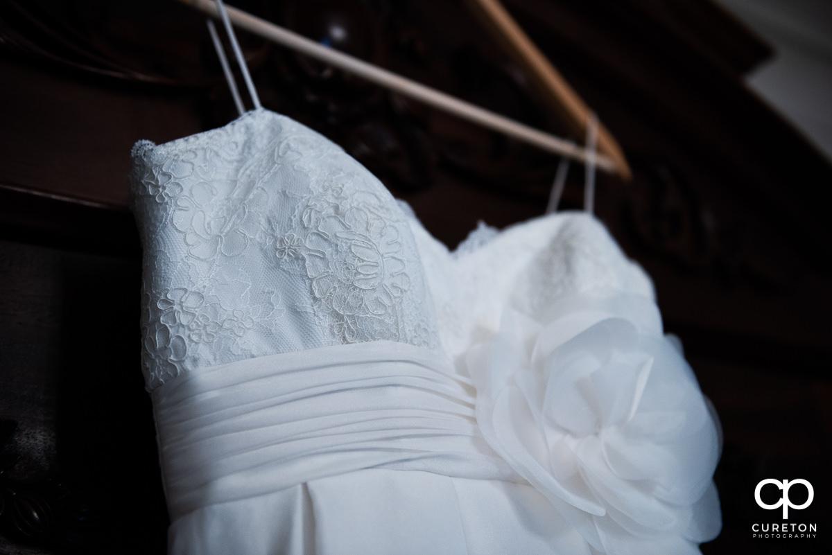 Closeup of bride's dress.