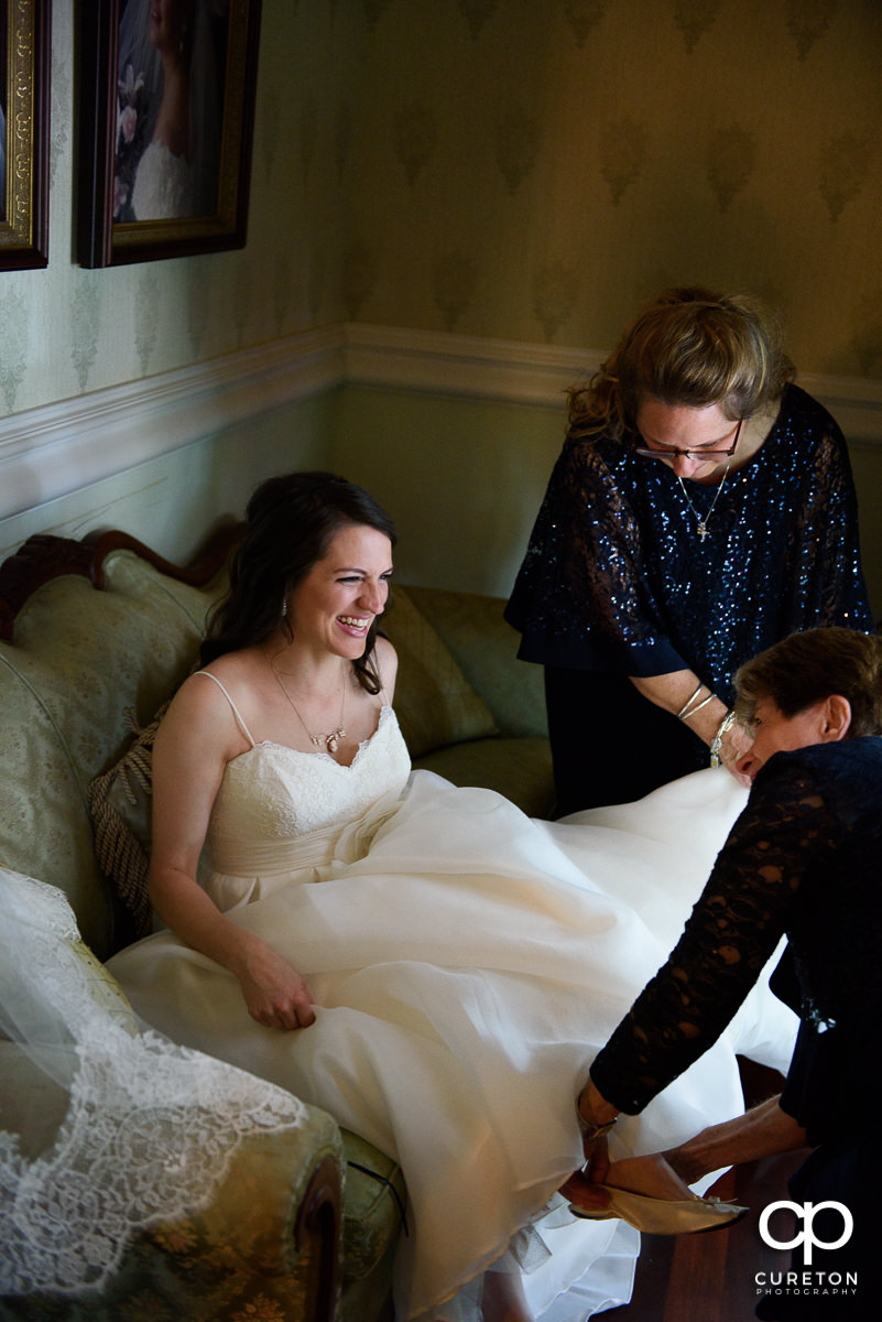 Bride laughing while getting ready in the bridal suite.