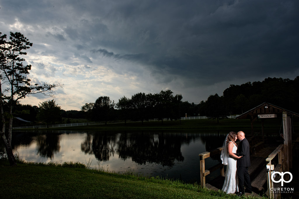 Bride and groom at sunset at the South Wind Ranch, a wedding venue in Travelers Rest, SC.