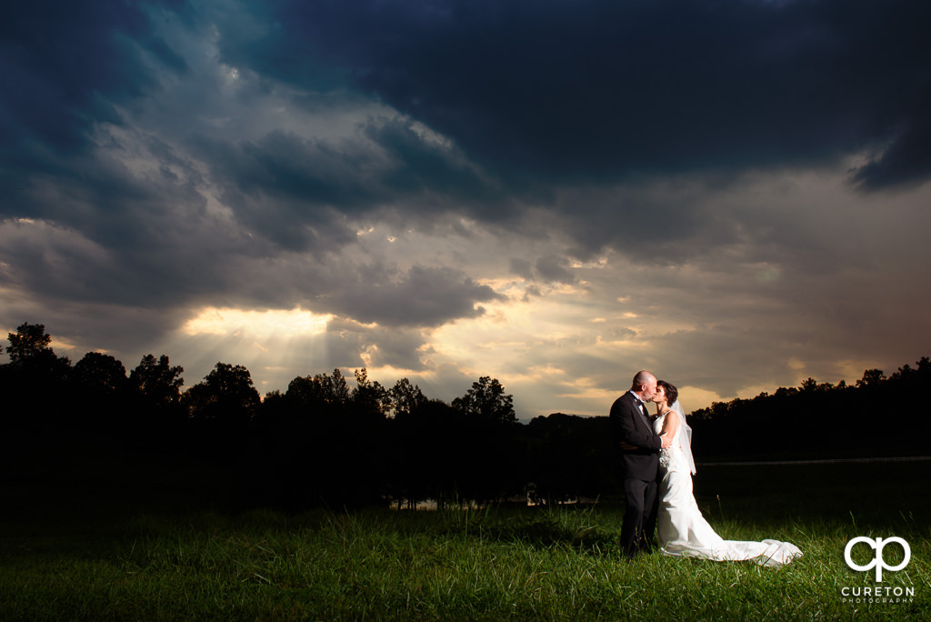 Bride and room at sunset after their wedding at South Wind Ranch in Travelers Rest SC.