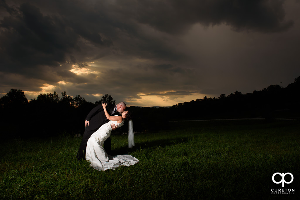 Bride and groom dipping after their wedding at South Wind Ranch in Travelers Rest SC.