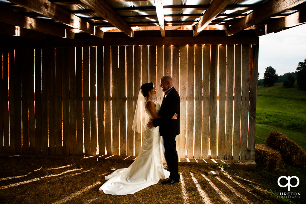Bride and Groom in front of the barn after their wedding at South Wind Ranch in Travelers Rest SC.
