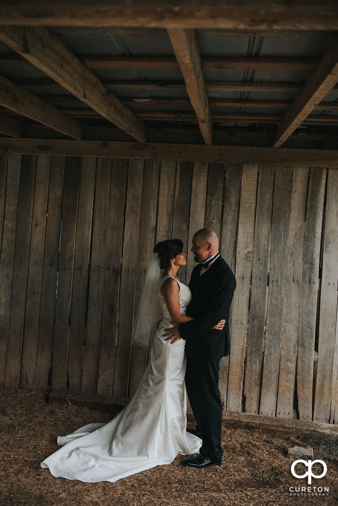Bride and groom in the barn at South Wind Ranch.