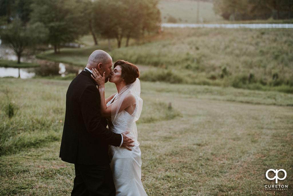Bride kissing her groom.