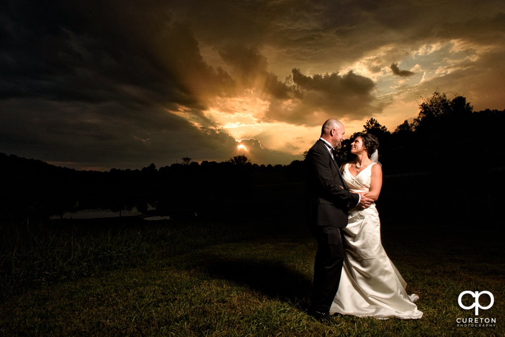 Bride and Groom staring at each other at sunset after their wedding at South Wind Ranch in Travelers Rest SC.
