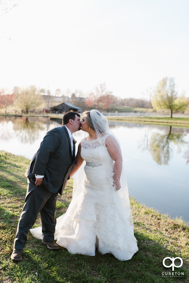 Bride and groom kissing after their ceremony at South Wind Ranch in Travelers Rest SC on their wedding day.