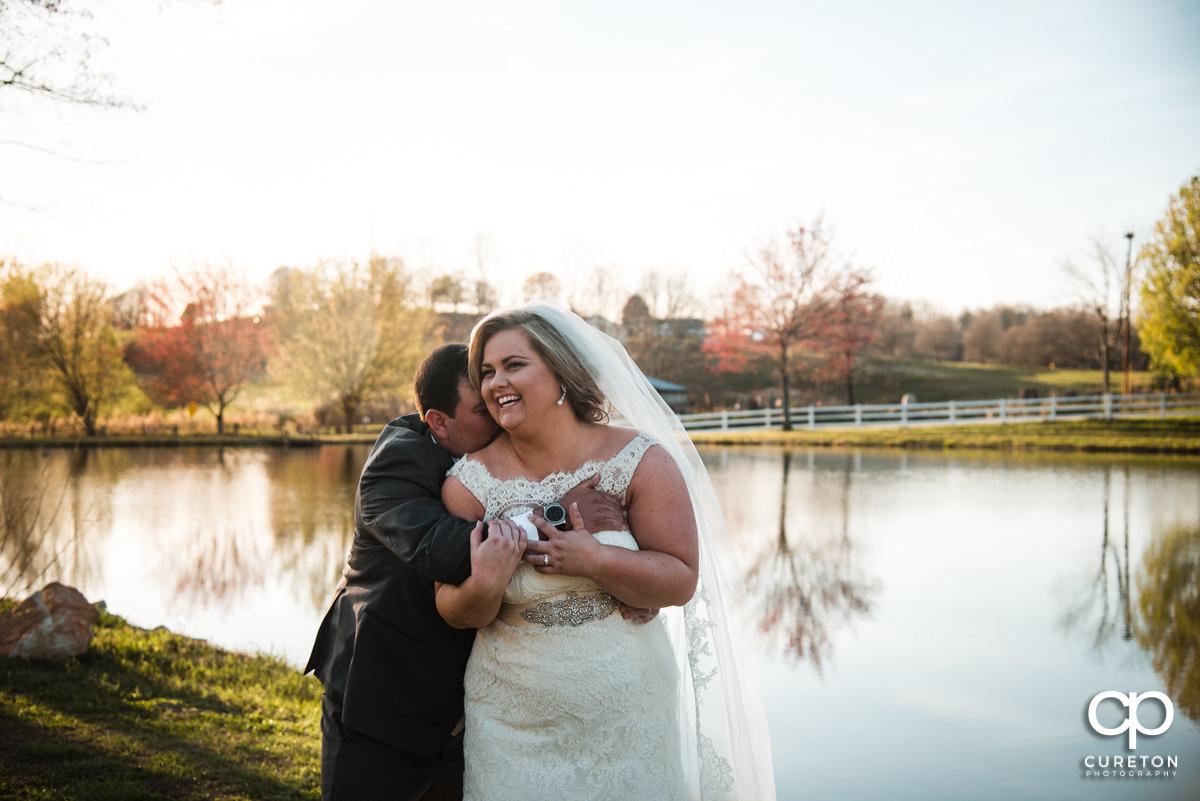 Bride and groom hugging.