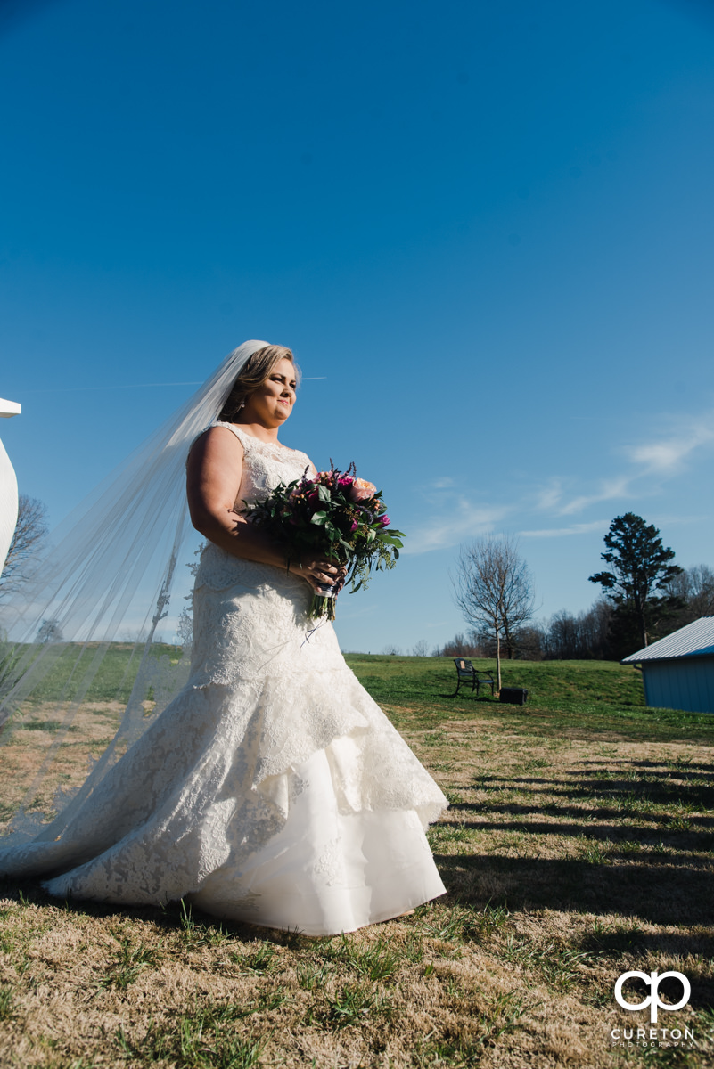 Bride walking down the aisle during her South Wind Ranch wedding in Travelers Rest,SC.