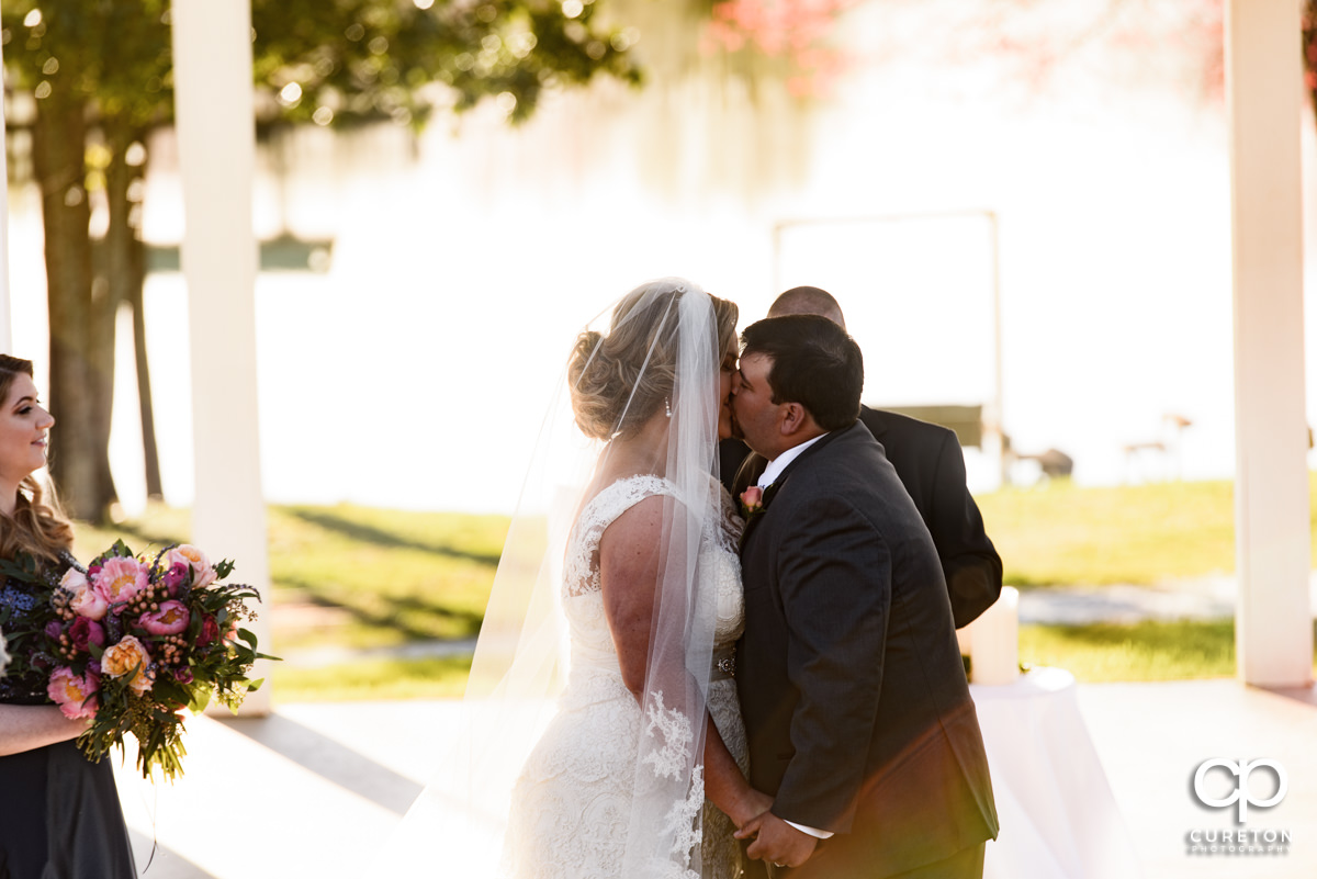 First kiss during their South Wind Ranch wedding in Travelers Rest,SC.
