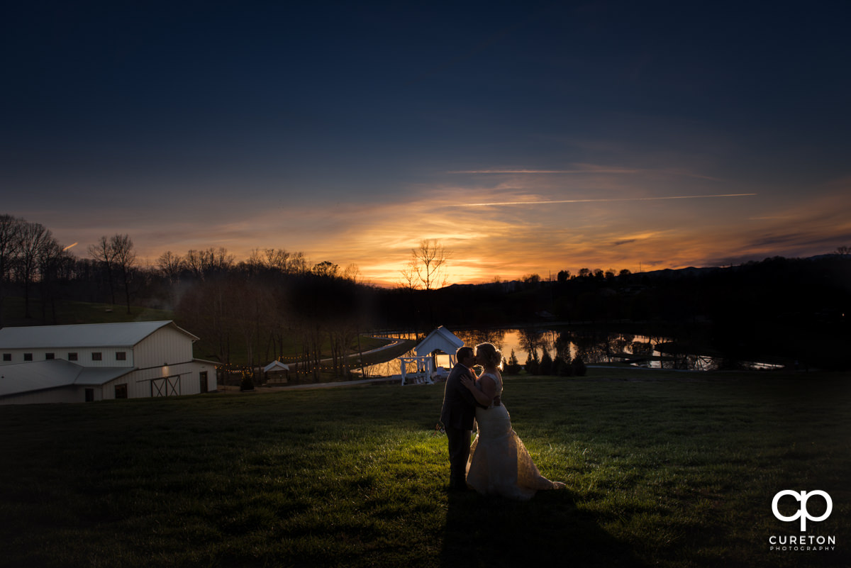 Bride and groom silhouette at South Wind Ranch on their wedding day.