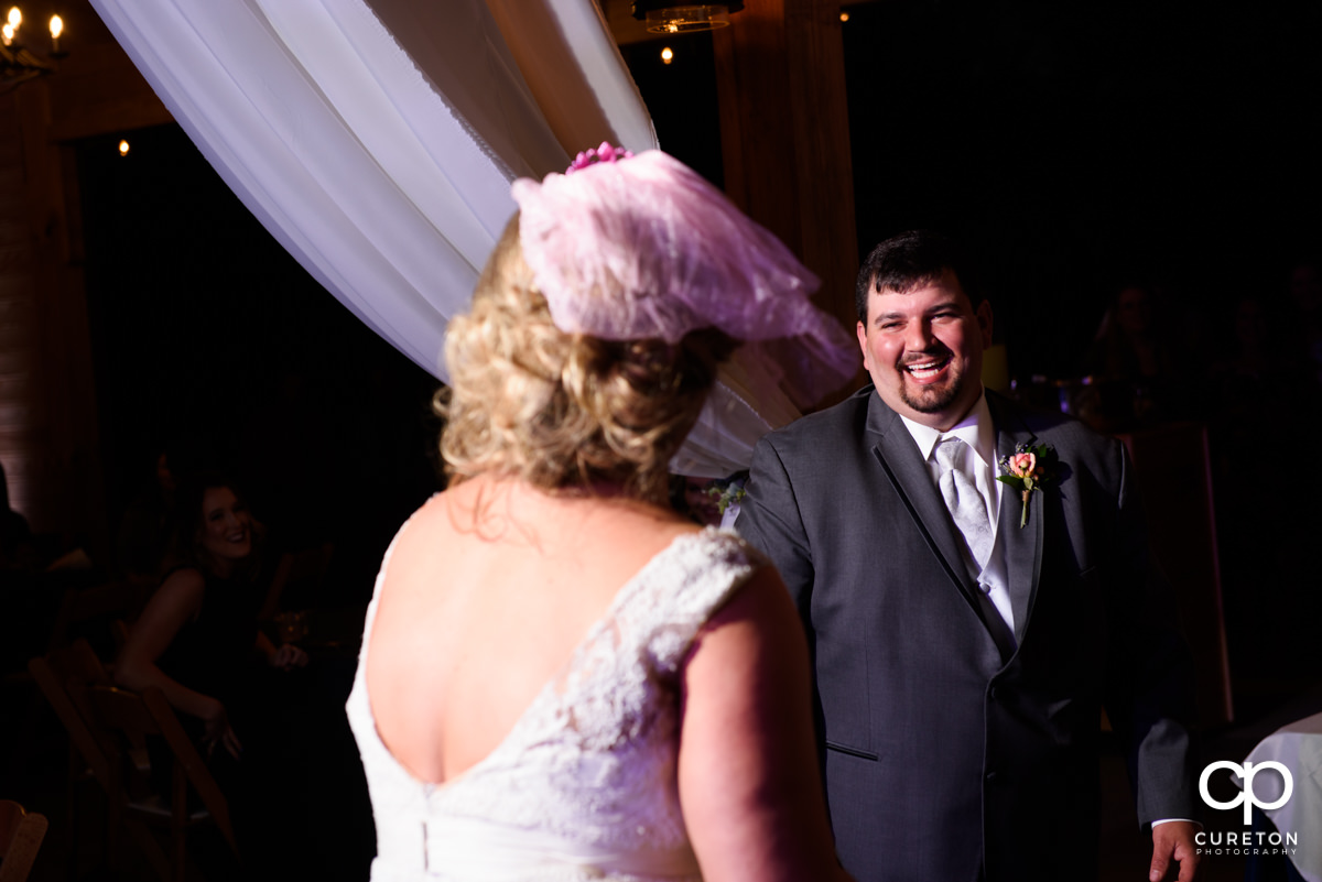 Groom laughing.