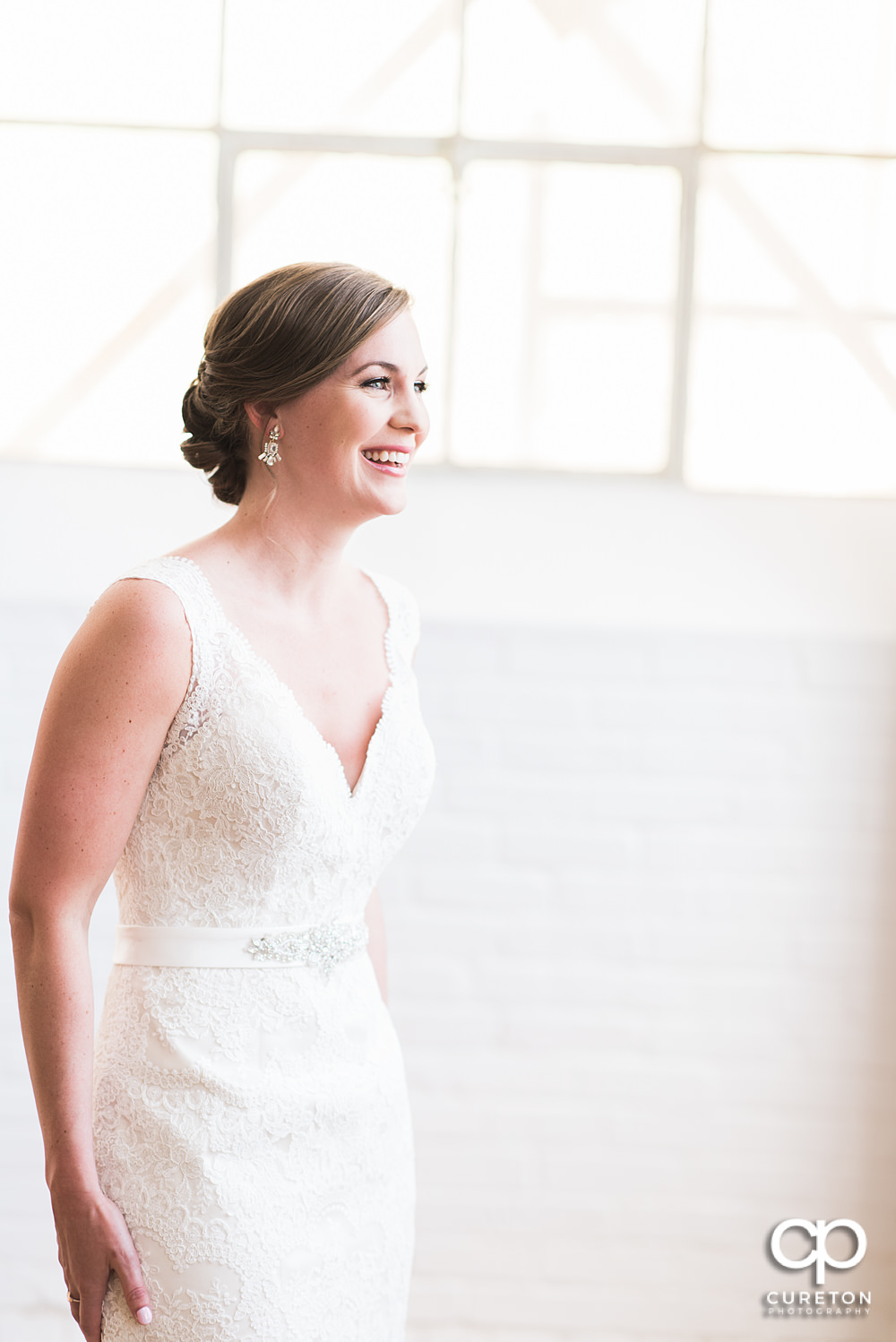 Bride laughing during her pre-wedding bridal session.