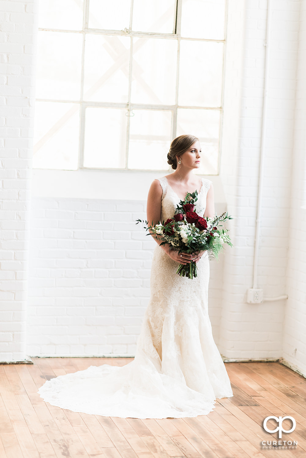 Bride holding her flowers bridal session at The Southern Bleachery wedding venue at the Taylor Mill.