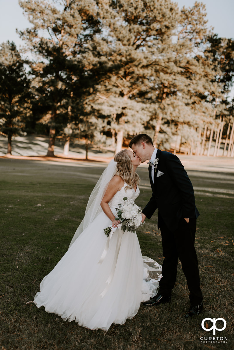 Bride kissing her groom after their Spartanburg Country Club wedding.
