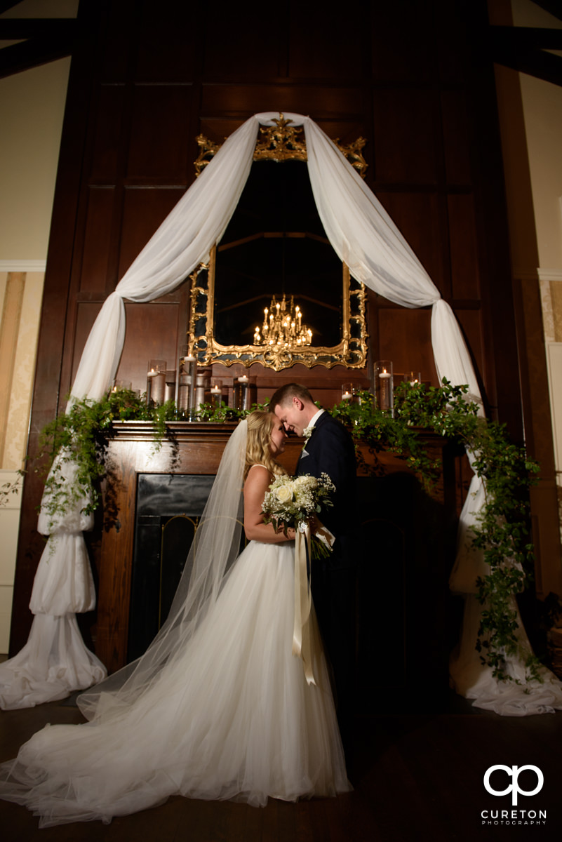Bride and groom at the alter of their wedding inside Spartanburg Country Club.