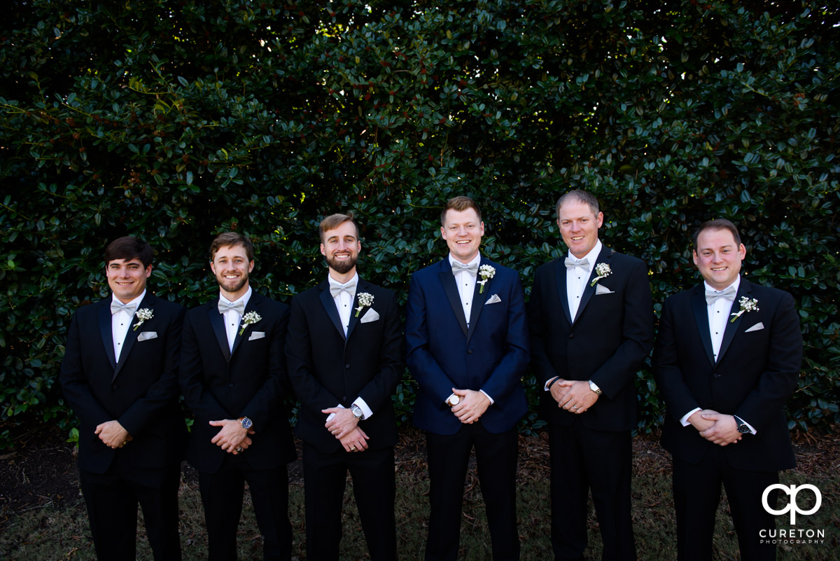 Groom and groomsmen hanging out before the wedding ceremony.