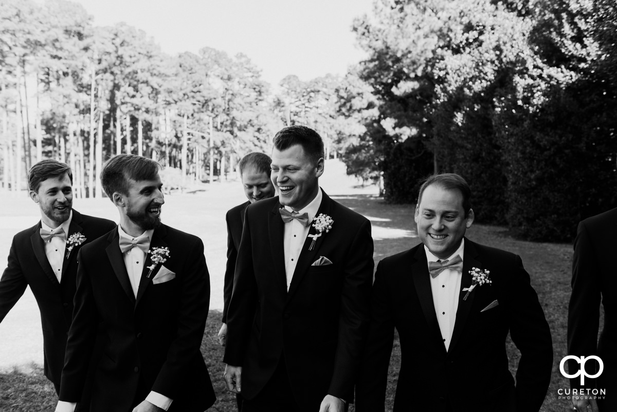 Groom laughing with his groomsmen before the ceremony.