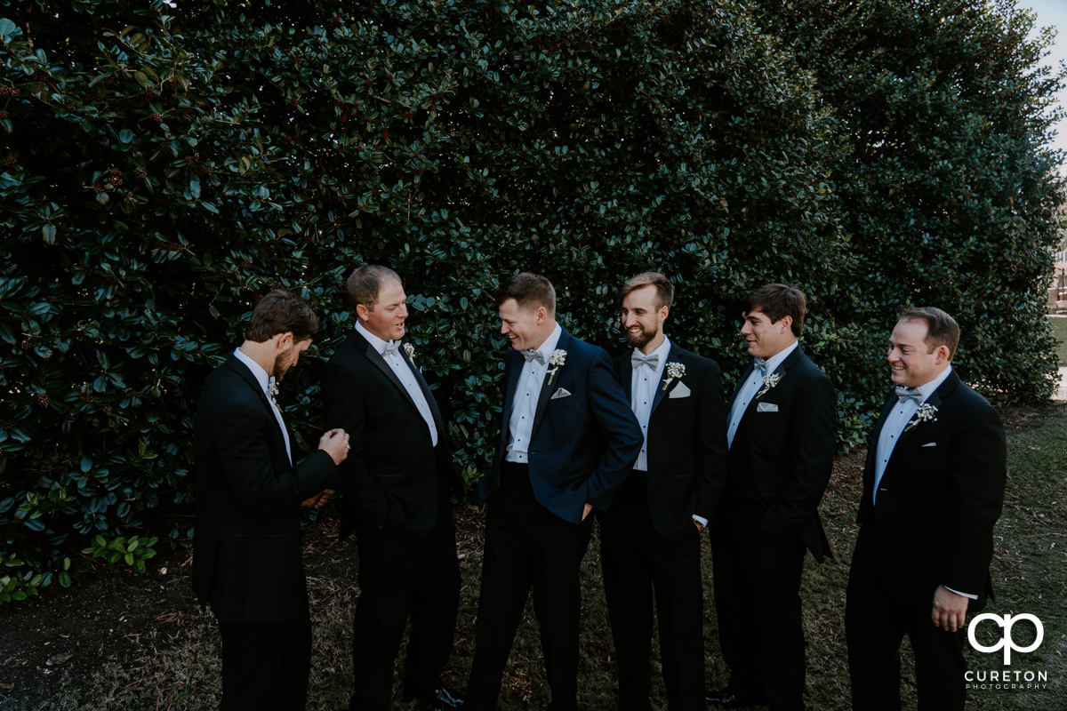 Groom and the groomsmen hanging out before the wedding ceremony at Spartanburg Country Club.