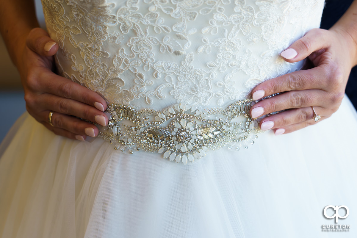 Intricate detail on the bride's dress.