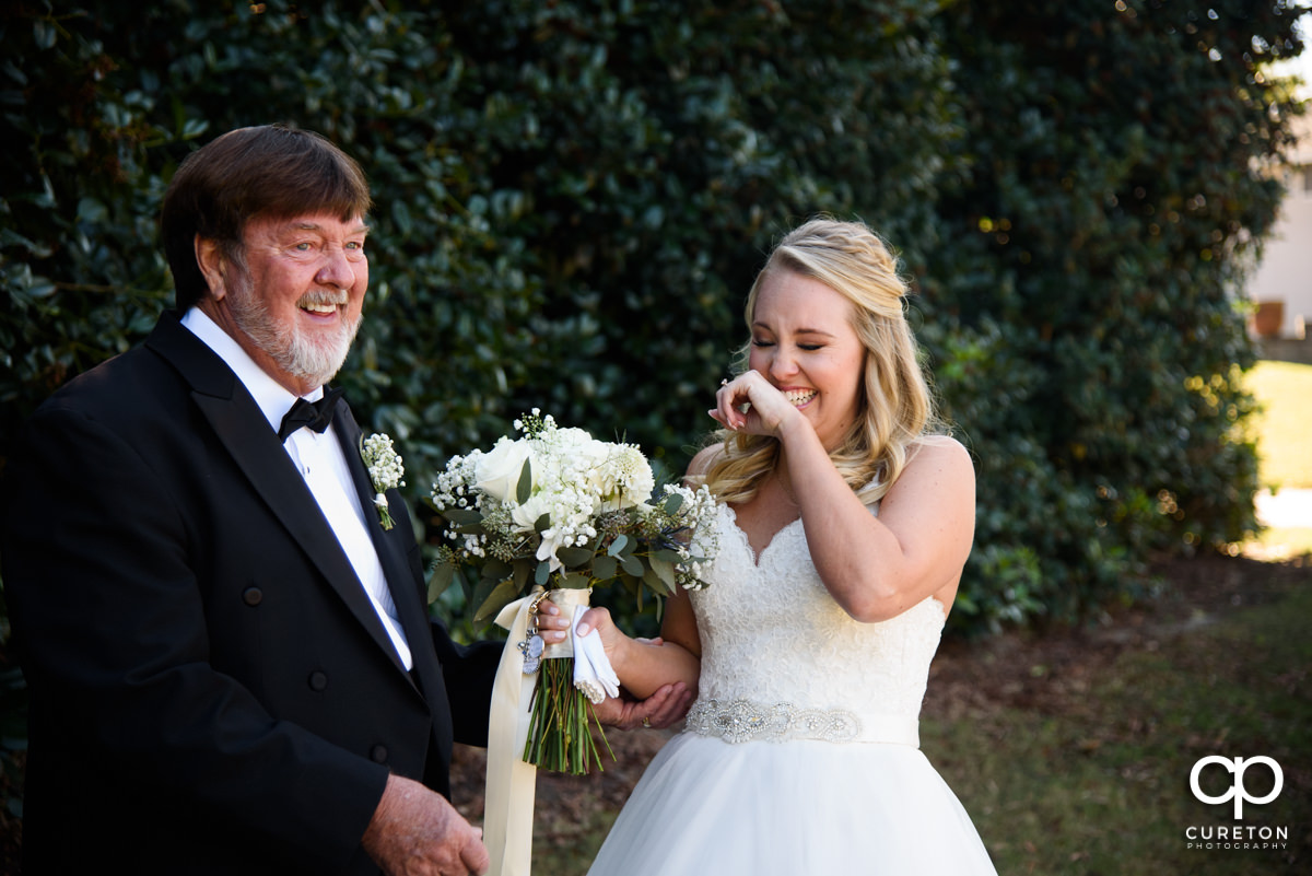 Bride and her father tearing up on the wedding day.