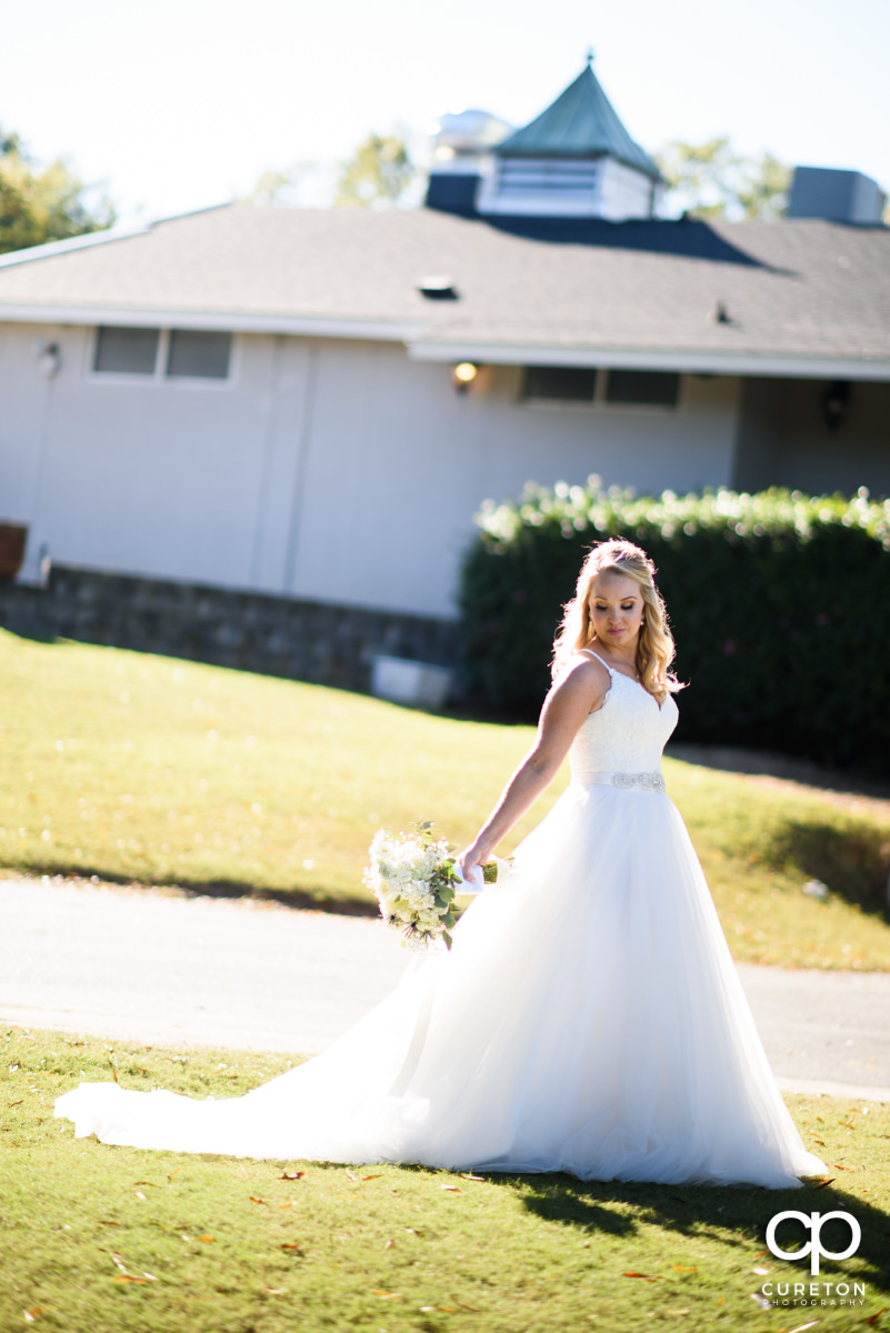 Beautiful bride in glowing sunlight.