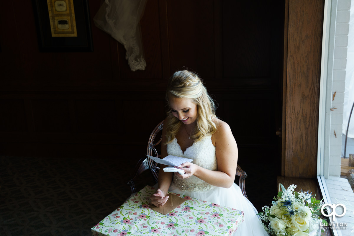 Bride reads a letter from her husband.