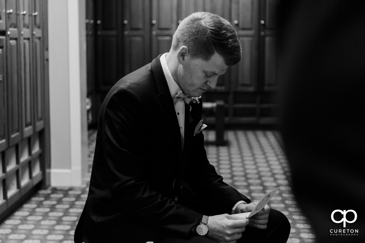 Groom reads a letter from his bride.