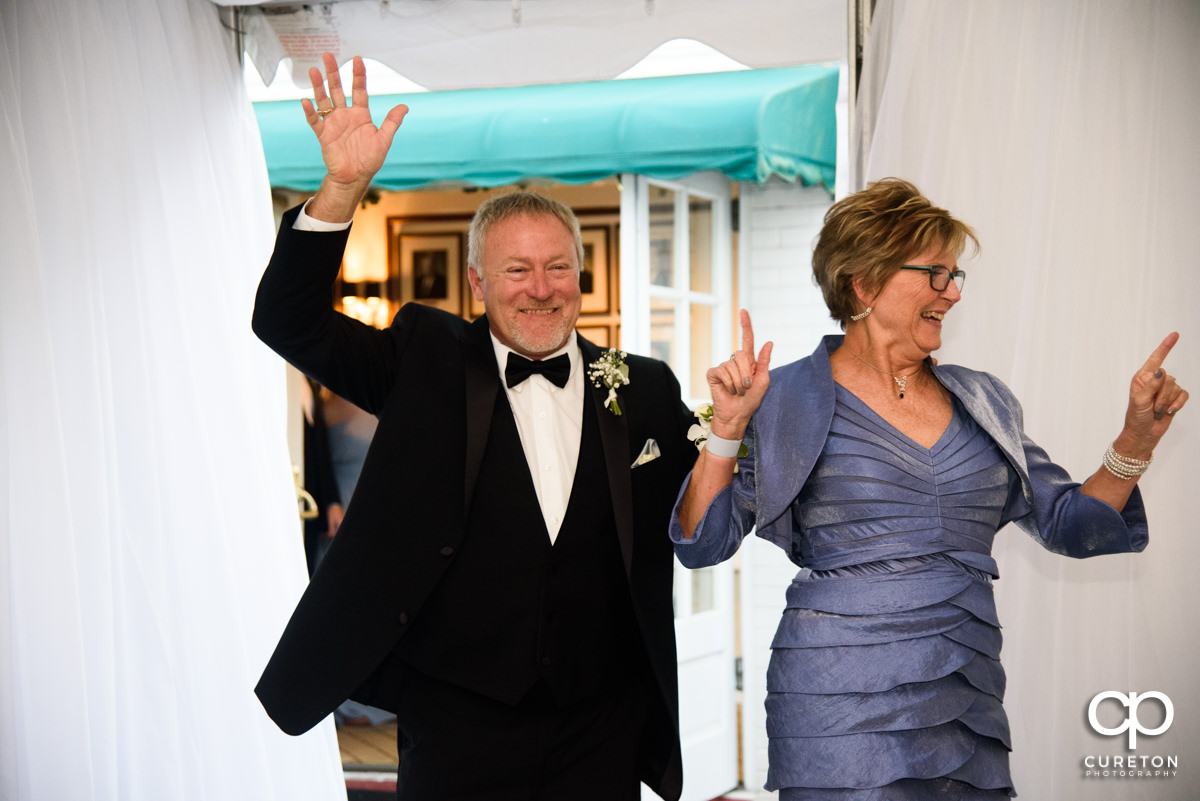 Parents of the groom making an entrance into the wedding reception.