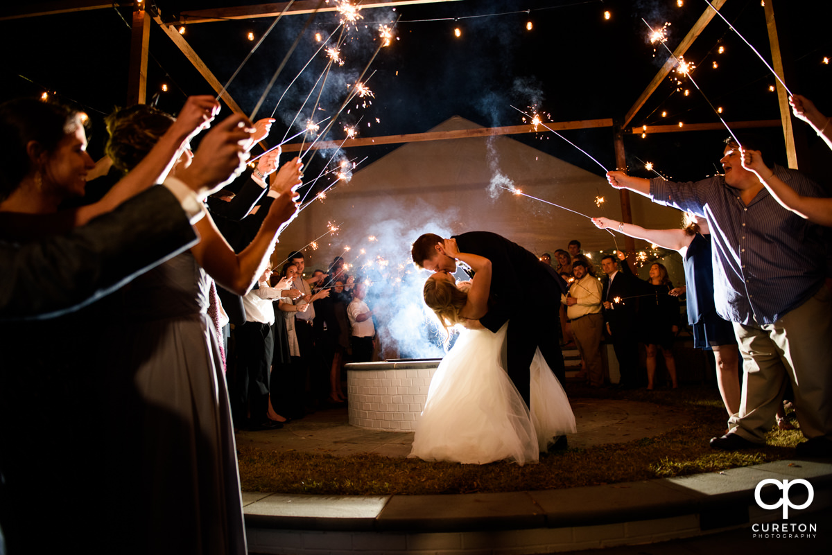 Bride and groom epic sparkler exit at the Spartanburg Country Club wedding reception.