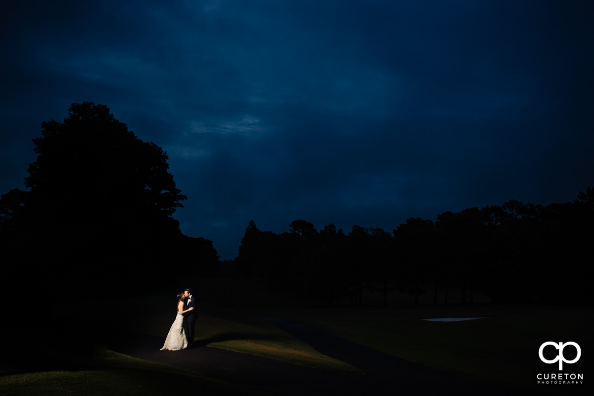 Bride and groom at sunset on the golf course at their wedding reception at Spartanburg Country Club.