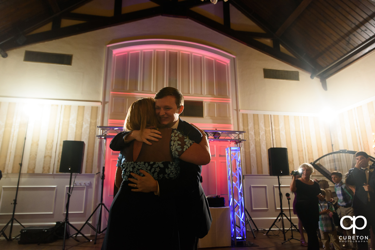 Groom dancing with his mother at the wedding reception at Spartanburg Country Club.