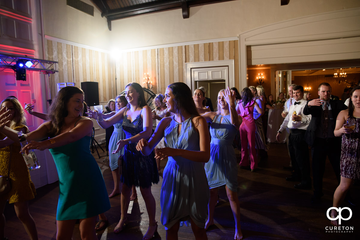 Wedding guests dancing to the sounds of DJ Ben Bruud at the wedding reception at Spartanburg Country Club.