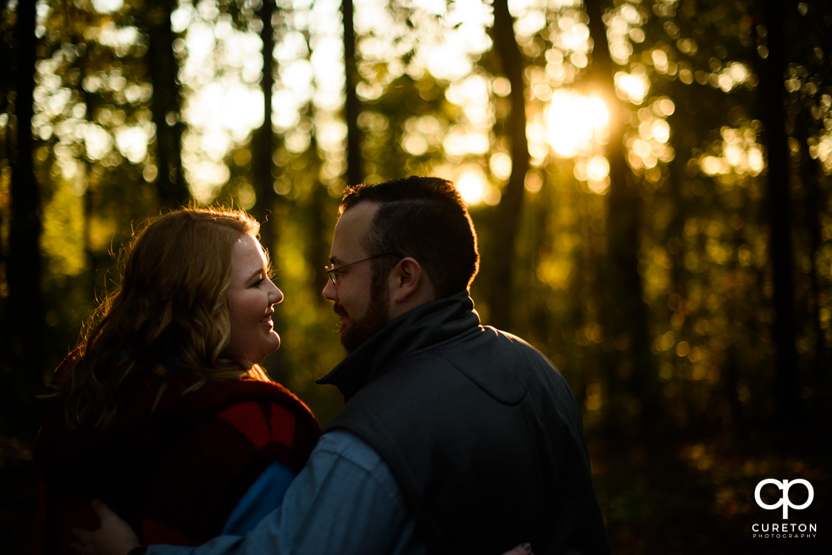 Future bride and groom looking at each other during a golden hour save the date session.