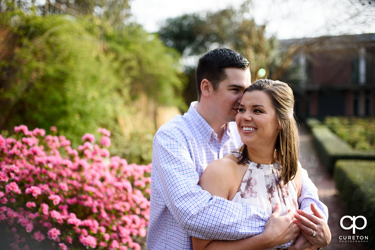 Man holding his fiancee during a Furman engagement session.