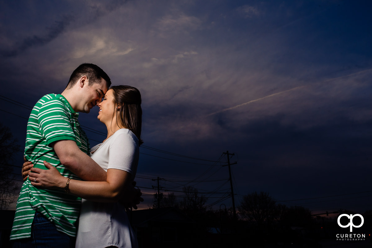 Bride and groom outside the Swamp Rabbit Brewery and Taproom during sunset at their engagement session.